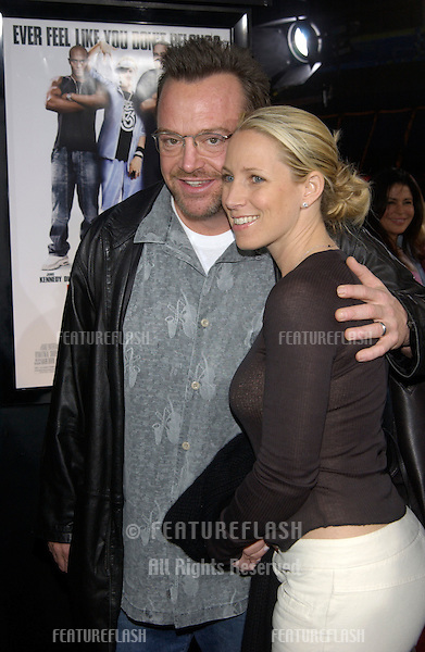Actor TOM ARNOLD & wife at the Los Angeles premiere of  Malibu's Most Wanted..April 10, 2003.