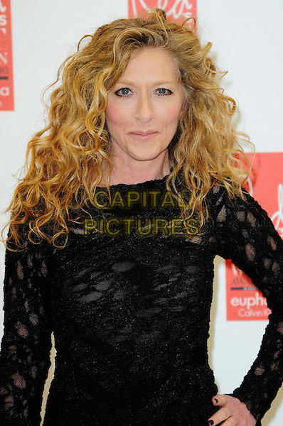KELLY HOPPEN .attends Red magazine's 'Red Hot Women Awards' at the Saatchi Gallery, London, England, UK, .November 30th 2010..half length black dress mesh knitted hand on hip .CAP/CAS.©Bob Cass/Capital Pictures.