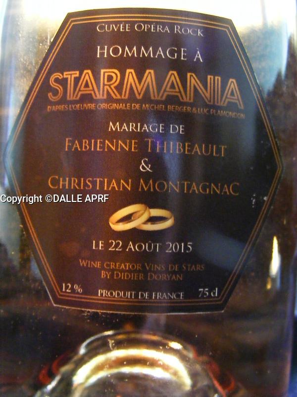 mariage de fabienne THIBAULT avec Christian Montagnac &agrave; castelnaud la chapelle le 22 ao&ucirc;t 2015, parc des Milandes ancienne propri&eacute;t&eacute; de Jos&eacute;phine Baker <br /> <br /> la boputeille de champagne avec l'etiquette speciale  Starmania!<br /> <br /> pas de credit;--merci<br /> <br /> <br /> <br /> -----------<br /> &copy;  DANISKA/DALLE