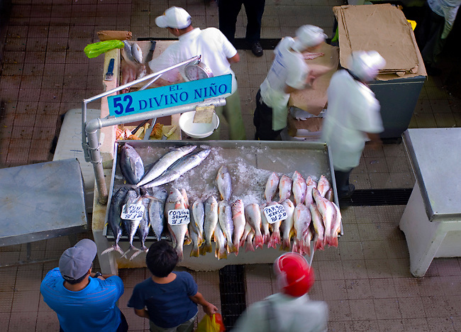 Customers wait for their fresh fish at the Fish Market (El Mercardo del Marisco) in the Casco Viejo neighborhood of Panama City, Panama.