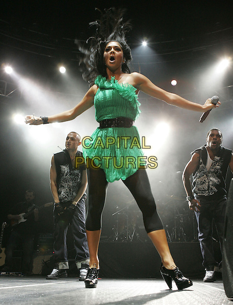 NICOLE SCHERZINGER.performs live at The 1st Annual 102.7 KIIS FM Homecoming Concert held at The Honda Center in Anaheim, LA, California, USA, October 27 2007..full length in concert live gig hand green dress black leggings   one shoulder boots belt hair funny         .CAP/DVS.©Debbie VanStory/Capital Pictures