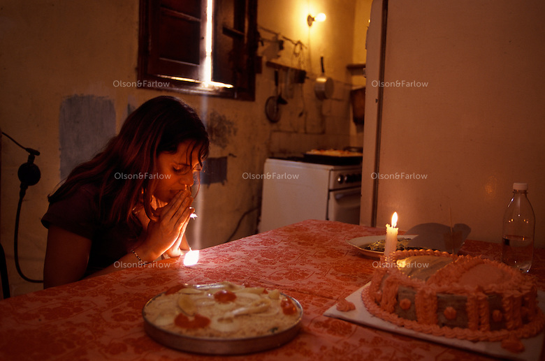 A young Cuban woman prays to the spirit of her grandfather after preparing a holiday meal. Ariadna Del Carmen Rodriguez--Single girl in the Cuban Underground. Ariadna is a young woman trying to lead an independent life and follow her dreams. Working as an actress in the theater, her charm is a mixture of innocence and a theatrical personality. She lives with a roommate in the city of Havana while she is going to school. She and her room mate are both actresses and wander through the academic and Cuban underground of artists and friends.