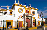 Colorful Plaza de Toros de la Maestranza, bull ring with horse carriage in downtown city of Seville, Sevilla, Spain