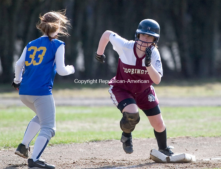 WATERBURY, CT- 07 APRIL 2008- 040708JT11-<br /> Torrington's Kylie Okenquist runs from third to home as Kennedy's Tayler Umbro scrambles for a loose ball during Monday's game at Municipal Stadium in Waterbury. Torrington won 13-6.<br /> Josalee Thrift / Republican-American