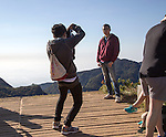 Tourists taking photos at the edge of World's End cliff at Horton Plains national park, Sri Lanka, Asia