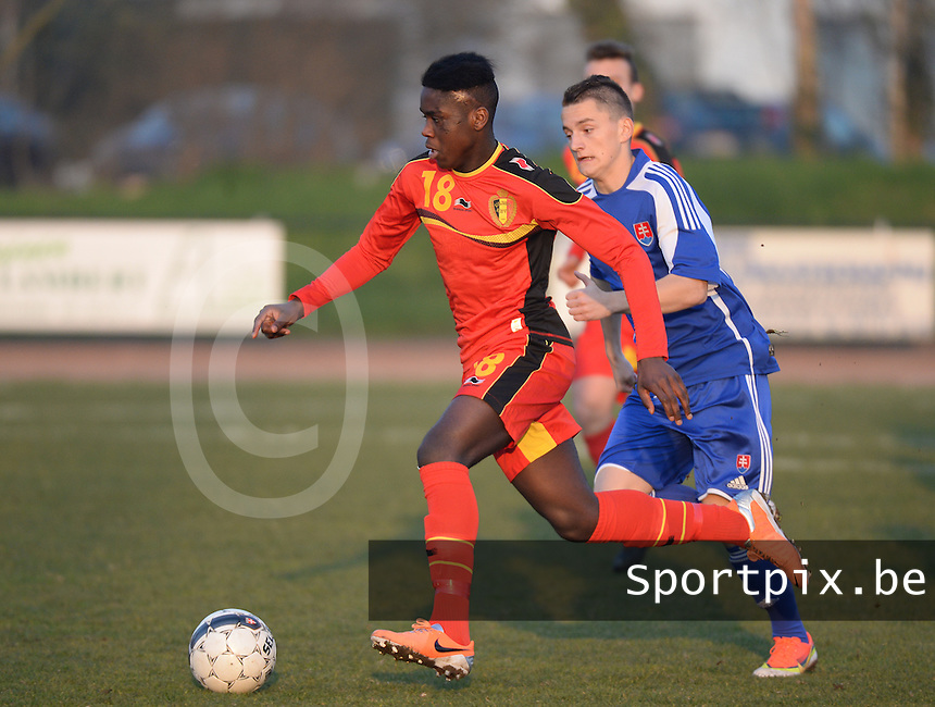 20140312 - MEULEBEKE , BELGIUM : Belgian Orel Mangala (18) pictured with Slovak Marek Teslar (10)  during a friendly soccer match between the Under16 soccerteams of Belgium and Slovakia , Wednesday 12 March 2014 in Meulebeke . PHOTO DAVID CATRY