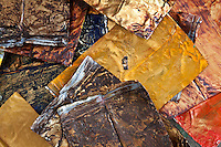 Discarded metal paint tubes which artist Dickens Otieno will clean and use in ametal weaving.