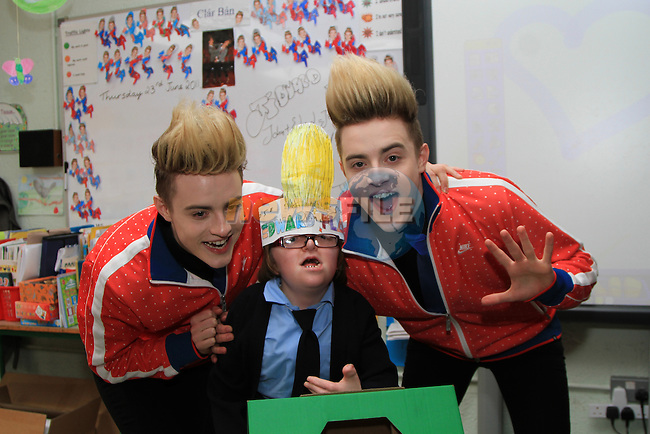 Presentation Primary School in Drogheda receive a visit from Jedward as the prize for collecting the most used mobile phones per student for the Jack and Jill Foundation, pictured here with Hannah Donnelly...(Photo credit should read Jenny Matthews www.newsfile.ie)....This Picture has been sent you under the conditions enclosed by:.Newsfile Ltd..The Studio,.Millmount Abbey,.Drogheda,.Co Meath..Ireland..Tel: +353(0)41-9871240.Fax: +353(0)41-9871260.GSM: +353(0)86-2500958.email: pictures@newsfile.ie.www.newsfile.ie.