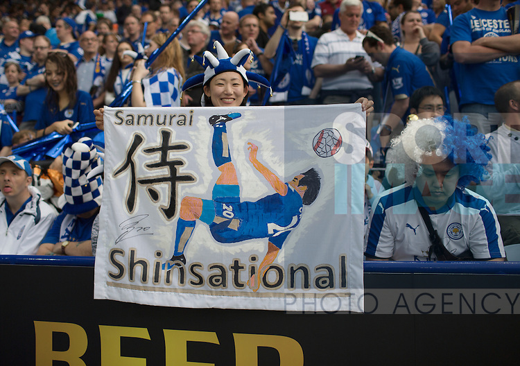 A Leicester fan holds a banner up for Shinji Okazaki during the Barclays Premier League match at the King Power Stadium.  Photo credit should read: David Klein/Sportimage