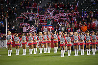 CARSON, CA - March 17, 2012: Chivas Girls during the National Anthem at the Chivas USA vs Vancouver Whitecaps FC match at the Home Depot Center in Carson, California. Final score Vancouver Whitecaps 1, Chivas USA 0.