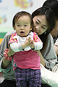 May 8, 2010 - Tokyo, Japan - A baby finished a 10 meters crawling competition called 'Babylympic' during the Maternity & Baby Festa 2010 show at Tokyo Big Sight, Japan, on May 8, 2010.Nearly 20,000 people are expected to attend the two-days annual event which features this season's maternity fashions, kids gear, pregnancy information sessions, maternity and exercise workshops for new mothers.