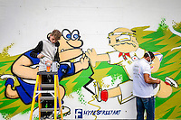 Street Artists paint a Scotland v Japan mural on the Coach and Horses pub near Kingsholm Stadium before the match - Mandatory byline: Rogan Thomson - 23/09/2015 - FOOTBALL - Bescot Stadium - Walsall, England - Walsall v Chelsea - Capital One Cup.