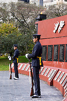 Monument commemorating the Falkland war Islas Malvinas on the Plaza San Martin Square, black marble plaques with names engraved of the soldiers in the war on red stone background, map of the island, two military honour guards in a park, Plaza San Martin Square renamed Plaza de la Fuerza Aerea or Plaza Fuerza Retiro Buenos Aires Argentina, South America