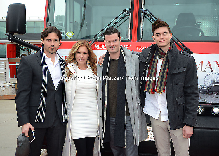 "Aaron Cameron,Tracey Bregman, sons Austin and Landon, star of The Young and the Restless""  getting her name on front of a  Ride of Fame Bus on April 7, 2014 in New York City."