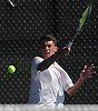 Cameron Klepper of Half Hollow Hills West returns a volley from Sandy Greenberg of Hills East (not in picture) in the second singles match of the Suffolk County varsity boys tennis team championship at Half Hollow Hills High School East on Wednesday, May 17, 2017.