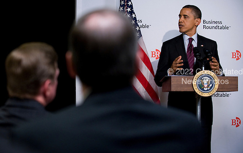 United States President Barak Obama meets with members of the Business Roundtable to discuss jobs and economic growth during a forum at the Newseum in Washington, DC USA 06 March 2012. Economists see slightly stronger growth and hiring than they did two months ago, trends that would help President Barack Obama's re-election hopes..Credit: Shawn Thew / Pool via CNP