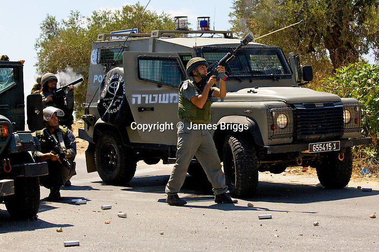 Israeli border police fire CS gas at (unseen) stone throwing Palestinian youths during protests against the expansion of the nearby Jewish settlement of Halamish, in the West Bank village of Nabi Saleh near Ramallah on 02/07/2010.