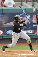 Third baseman Julio De La Cruz (15) of the Bristol Pirates runs out a ground ball bats in a game against the Pulaski Yankees on Tuesday, July 5, 2016, at Calfee Park in Pulaski, Virginia. Pulaski won, 6-3. (Tom Priddy/Four Seam Images)