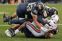 The Pitt defense lead by Shane Roy (93) gang tackles Virginia running back OLamide Zaccheaus.The Pitt Panthers defeated the Virginia Cavaliers 31-14 at Heinz Field, Pittsburgh, PA on October 28, 2017.