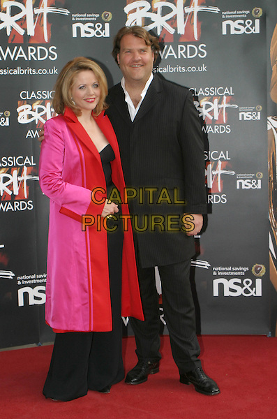 RENEE FLEMING & BRYN TERFEL.Attends the Classical Brit Awards 2004 at The Royal Albert Hall, London..full length full-length fushia pink red trimed coat.www.capitalpictures.com.sales@capitalpictures.com.©Capital Pictures