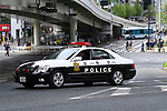 Police officers check cars on a road near the Imperial Palace in Tokyo, Japan on May 1, 2019, the first day of the Reiwa Era. (Photo by MATSUO.K/AFLO)