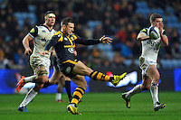 Jimmy Gopperth of Wasps puts boot to ball. European Rugby Champions Cup match, between Wasps and Bath Rugby on December 13, 2015 at the Ricoh Arena in Coventry, England. Photo by: Patrick Khachfe / Onside Images