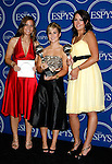 College softball athletes Mallory Holtman, Sara Tucholsky and Liz Wallace pose in the press room at the 2008 ESPY Awards held at NOKIA Theatre L.A. LIVE on July 16, 2008 in Los Angeles, California.