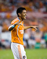 Houston Dynamo forward Brian Ching (25) celebrates his second goal of the game.  Houston Dynamo defeated D.C. United 4-3 at Robertson Stadium in Houston, TX on August 1, 2009.