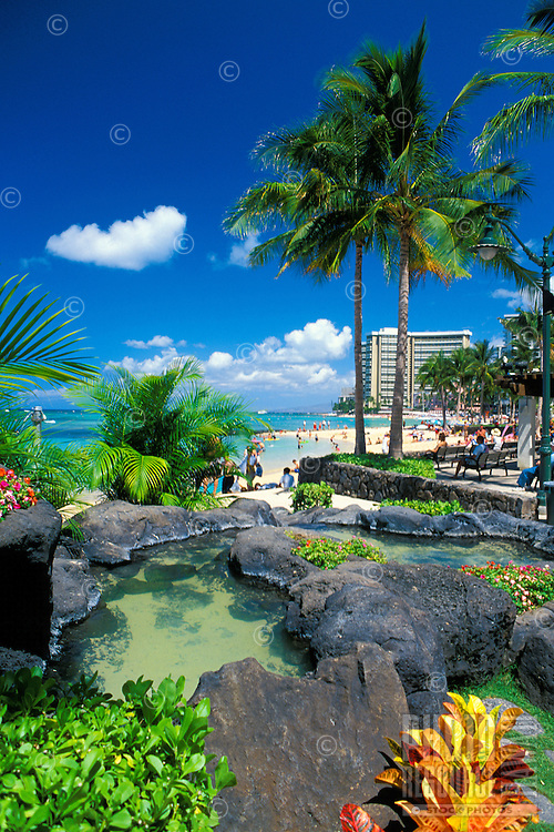 The newly renovated Waikiki Historic trail offers visitors the opportunity to smell beautiful island flowers, see water fountains and statues or just relax on manicured green grass next to the beach.. Located along Kalakaua ave. parallel to Waikiki
