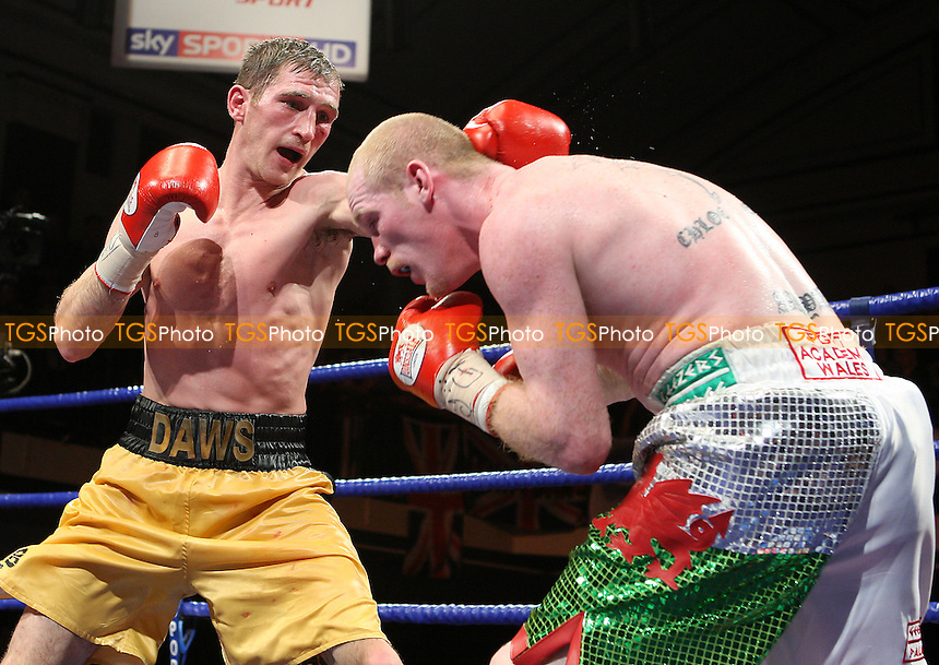 Lenny Daws (yellow shorts) draws with Jason Cook in a Light-Welterweight boxing contest to retain the British Title at York Hall, Bethnal Green, promoted by Barry Hearn / Matchroom Sports - 12/02/10 - MANDATORY CREDIT: Gavin Ellis/TGSPHOTO - Self billing applies where appropriate - Tel: 0845 094 6026