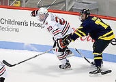 Colton Saucerman (NU - 23), Ben Bahe (Merrimack - 17) - The Northeastern University Huskies defeated the visiting Merrimack College Warriors 4-2 (EN) on Wednesday, October 10, 2012, at Matthews Arena in Boston, Massachusetts.