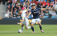 Leeds United's Adam Forshaw and Millwall's Lee Gregory<br /> <br /> Photographer Rob Newell/CameraSport<br /> <br /> The EFL Sky Bet Championship - Millwall v Leeds United - Saturday 15th September 2018 - The Den - London<br /> <br /> World Copyright &copy; 2018 CameraSport. All rights reserved. 43 Linden Ave. Countesthorpe. Leicester. England. LE8 5PG - Tel: +44 (0) 116 277 4147 - admin@camerasport.com - www.camerasport.com