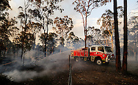 A firefighter works on a bushfire near Sydney September 10, 2013. The Australian bushfire season has started early and is predicted to be a busy one as record high temperatures, strong winds and dry weather hit most of the country. Stringer/VIEWPRESS