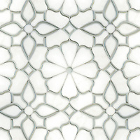 Estelle, a waterjet stone and Serenity glass mosaic, shown in honed Thassos and Tropical White glass, is part of the Parterre Collection by Sara Baldwin for New Ravenna.
