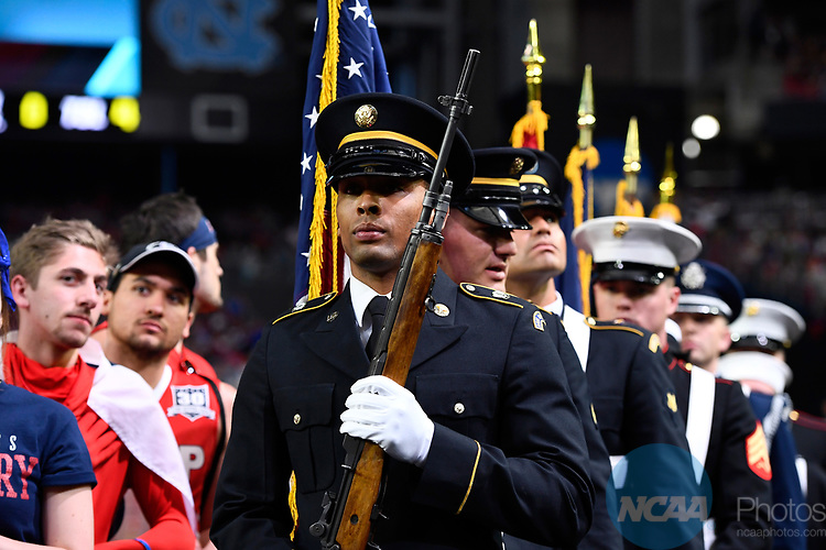 GLENDALE, AZ - APRIL 03: Armed forces members march out to the court prior to the national anthem during the 2017 NCAA Men's Final Four National Championship game at University of Phoenix Stadium on April 3, 2017 in Glendale, Arizona.  (Photo by Brett Wilhelm/NCAA Photos via Getty Images)