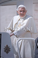 Pope Benedict XVI waves as he leaves his weekly general audience on  April 7, 2010 at St Peter's square at The Vatican.