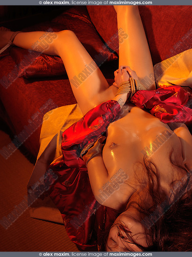 Beautiful naked asian woman with tied hands. Sensual Japanese bondage Shibari.