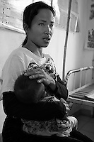 Health center Cambodia. A woman is holding her baby at Trapeng Andeuk health center. Trapeng Andeuk, Takeo province, Cambodia-2009