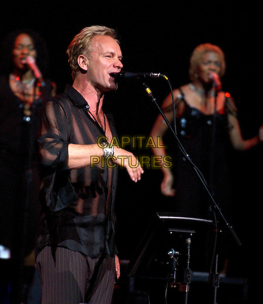 STING.performs live as part of his Sacred Love Tour 2004 at The Pantages Theatre in Hollywood, California .10 February 2004   .*UK Sales Only*                                                .music, live, stage, singing, concert, gig.www.capitalpictures.com.sales@capitalpictures.com.©Capital Pictures.
