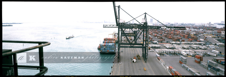 The port of Miami runs east and west by Government Cut. On the south side container ships get unloaded by 300 foot cranes. On the north side is the Cruise Ship docks. On the east end is the PILOT house, where captains bring the ships into port. On the West end is the only road into the port throught downtown Miami.