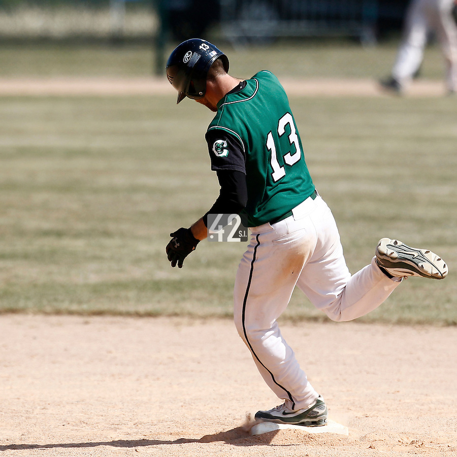 15 July 2011: Alex Couton of Montigny runs the bases after his home run during the 2011 Challenge de France match won 10-7 by the Montpellier Barracudas over Montigny Cougars, in Les Andelys, near Rouen, France.