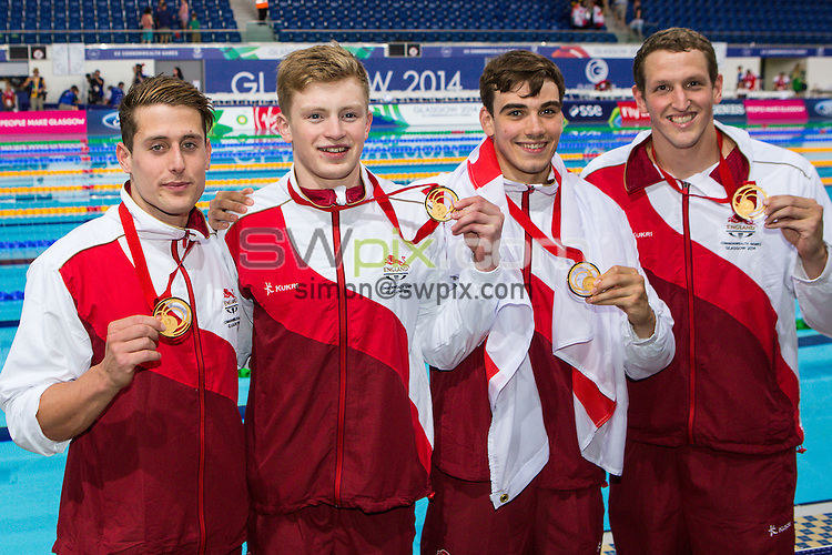 Picture by Alex Whitehead/SWpix.com - 29/07/2014 - 2014 Glasgow Commonwealth Games, Day 6 - Swimming - Tollcross Swimming Centre, Glasgow, Scotland - (from left) England's Chris Walker-Hebborn, Adam Peaty, Adam Barrett and Adam Brown celebrate winning the Men's 4x100m Individual Medley Relay Final.
