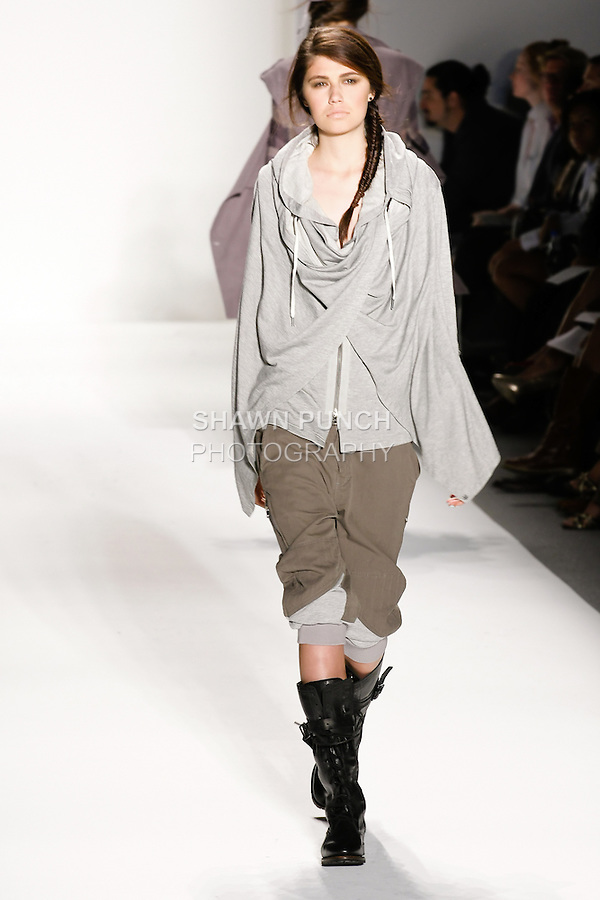Model walks the runway in an outfit by Nicholas and Christopher Kunz, from the Nicholas K Spring Summer 2011 collection, during Mercedes-Benz Fashion Week at Lincoln Center, September 9, 2010.