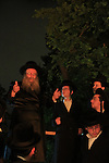 Israel, Lag B'Omer holiday in Tel Aviv, the Rabbi and his Hasidim by the fire