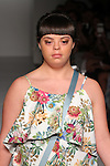 """Model walks runway in an outfit from a the Michelle Ann Spring Summer """"Tropical Paradise"""" collection for the Designer's Collective Spring Summer 2017 fashion show during Fashion Gallery New York Fashion Week Spring Summer 2017 on September 10, 2016."""