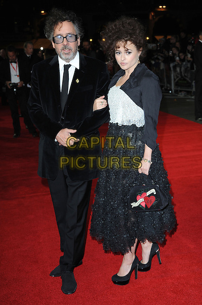Tim Burton and Helena Bonham Carter .The 'Frankenweenie 3D' opening gala, 56th BFI London Film Festival, Odeon Leicester Square cinema, London, England..October 10th, 2012.full length black suit arms linked glasses couple bolero jacket white top skirt lace handbag purse heart print .CAP/BEL.©Tom Belcher/Capital Pictures.