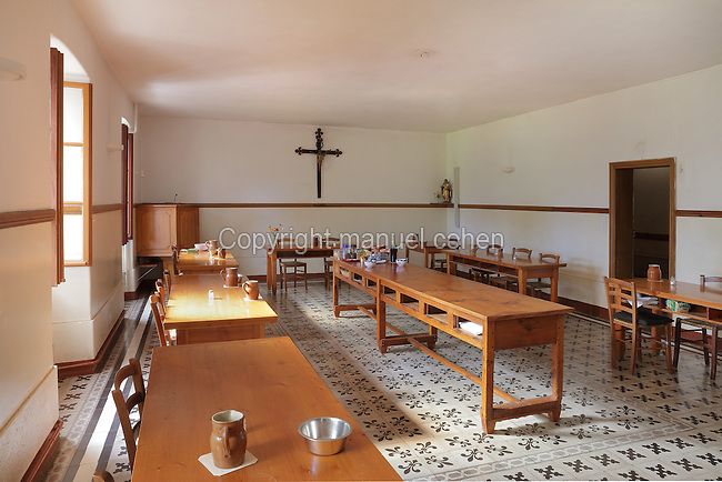 Refectory of the Monastere Sainte Catherine de Sienne, or Monastery of St Catherine of Siena, founded 1623 by St Agnes of Jesus, or St Agnes of Langeac, 1602-34, Langeac, Haute Loire, Auvergne, France. In the far right corner is a statue of St Agnes, who was prioress here from 1627. Picture by Manuel Cohen