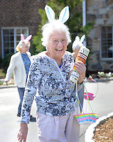 SOUTHAMPTON, PA - APRIL 17:  Marie Reichert wears bunny ears and holds her Easter basket as she participates in an Easter Egg hunt for residents at Southampton Estates April 17, 2014 in Southampton, Pennsylvania. (Photo by William Thomas Cain/Cain Images)