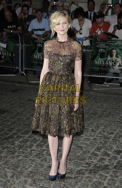 Kirsten Dunst (wearing new fashion label Honor's spring 2012 collection).UK Premiere of 'Melancholia' at the Curzon, Mayfair, London, England..September 28th 2011.full length organza paisley printed dress gold woven weave sheer black brown.CAP/CAN.©Can Nguyen/Capital Pictures.