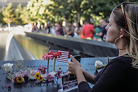 NEW YORK, NY - SEPTEMBER 11: People look over the north memorial pool during the 15th anniversary of the 9/11 attacks on September 11, 2016 in New York. Photo by (VIEWpress/Maite H. Mateo)